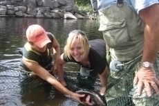 The smile says it all. Erin Gillis gets to hold her first Margaree salmon.