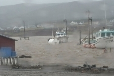 High water at wharf in Belle Cote